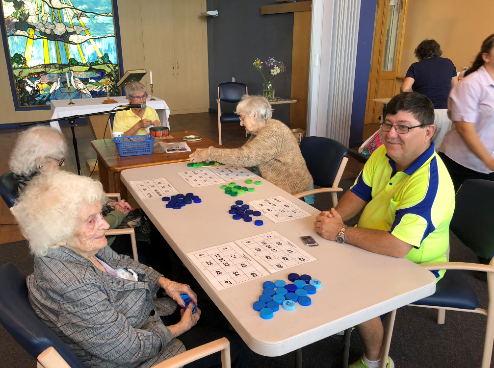 Mai-Wel Labour Force Solutions job seeker Edward pictured with aged care residents during his work experience